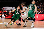 22nd March 2018, Wizink Centre, Madrid, Spain; Turkish Airlines Euroleague Basketball, Real Madrid versus Zalgiris Kaunas; Vasilije Micic (Zalgiris Kaunas) brings the ball foward Luka Doncic (Real Madrid Baloncesto) past the picked Antanas Kavaiauskas (Zalgiris Kaunas)