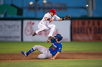 Orem Owlz second baseman Justin Jones (33) leaps over James Outman (47) on a stolen base attempt during a Pioneer League game against the Ogden Raptors at Home of the OWLZ on August 24, 2018 in Orem, Utah. The Ogden Raptors defeated the Orem Owlz by a score of 13-5. (Zachary Lucy/Four Seam Images)