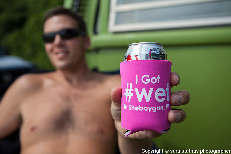 Chris Pernat of Sheboygan, Wisconsin shows off a beverage coozie representing the surf culture of his home town.