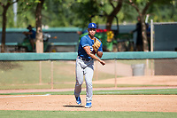 Los Angeles Dodgers third baseman Marcus Chiu (22) throws to first base during an Instructional League game against the Oakland Athletics at Camelback Ranch on October 4, 2018 in Glendale, Arizona. (Zachary Lucy/Four Seam Images)