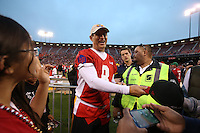 SAN FRANCISCO, CA - JULY 12:  Former San Francisco 49ers great Steve Young signs autographs during the Legends of Candlestick flag football game at Candlestick Park in San Francisco, California on July 12, 2014. Photo by Brad Mangin