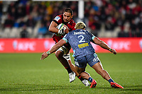 25th July 2020, Christchurch, New Zealand;  Whetukamokamo Douglas of the Crusaders is tackled by Asafo Aumua of the Hurricanes during the Super Rugby Aotearoa, Crusaders versus Hurricanes at Orangetheory stadium, Christchurch
