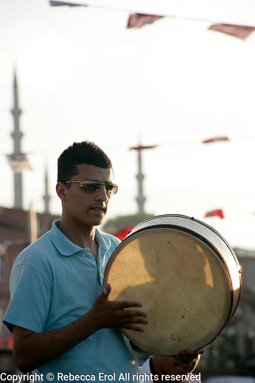 Turkish boy plays the drum in Eminonu, istanbul, Turkey
