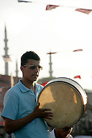 Turkish boy plays the drum in Eminonu, istanbul, Turkey