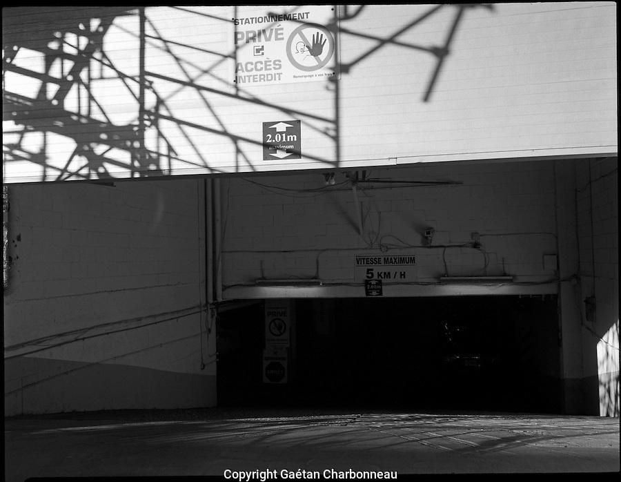Shadow play on a large aluminium garage door