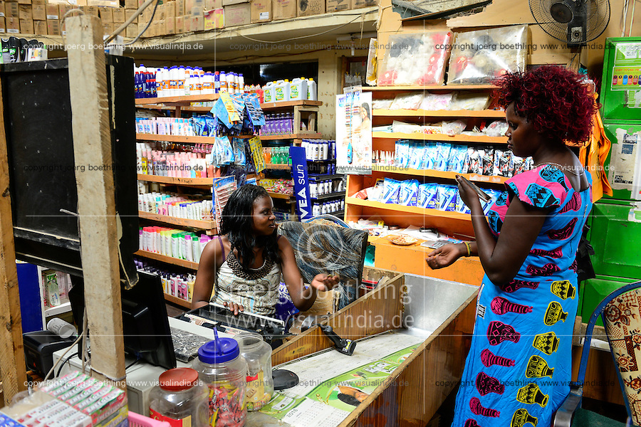 KENYA Turkana, Lodwar, small supermarket selling food items and other goods for the daily demand, woman with wig / KENIA, kleiner Supermarkt, Kasse