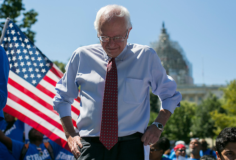 UNITED STATES - JULY 22: Democratic presidential candidate Sen. Bernie Sanders, I-Vt., prepares to speak to federal contract workers during a rally on Capitol Hill in Washington, Wednesday, July 22, 2015, to push for a raise to the minimum wage to $15 an hour. (Photo By Al Drago/CQ Roll Call)