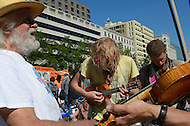"October 6, 2011  (Washington, DC)  Dan Scanlan (left), a ukulele player from Nevada City, California, who also goes by the name ""Cool Hand Yuke"", joined three other musicians for an impromptu performance at Freedom Plaza in DC.  Hundreds of people from around the country descended on Washington for ""Occupy DC"", a movement that has spread from New York City's ""Occupy Wall Street""    (Photo by Don Baxter/Media Images International)"