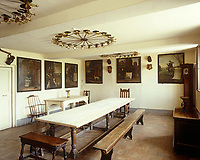 The servants' dining room at Erddig Hall is lined with the portraits of past workers