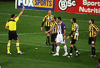 Referee Peter O'Leary yellow-cards Manny Muscat during the A-League football match between Wellington Phoenix and Perth Glory at Westpac Stadium, Wellington, New Zealand on Sunday, 16 August 2009. Photo: Dave Lintott / lintottphoto.co.nz
