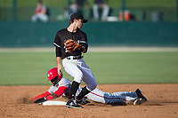 Kannapolis Intimidators shortstop Grant Massey (28) turns to attempt to put a tag on Telmito Agustin (8) of the Hagerstown Suns as he steals second base at Kannapolis Intimidators Stadium on June 15, 2017 in Kannapolis, North Carolina.  The Intimidators walked-off the Suns 5-4 in game one of a double-header.  (Brian Westerholt/Four Seam Images)