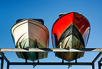 Drydocked motor boats.