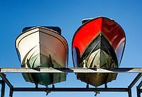 Drydocked motor boats.