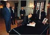 United States President Ronald Reagan signs a condolence book for the late Prime Minister Indura Gandhi of India on Wednesday, October 31, 1984 at the Embassy of India in Washington, D.C.  Also present were (from left): George Shultz, Secretary of State; Robert McFarlane, Assistant to the President for National Security Affairs; Ambassador K.S. Bajpai of India; and Embassy of India officials P.S. Sahai, Minister of Commerce, and Deepak Vohra, First Secretary for Press..Mandatory Credit: Mary Anne Fackelman - White House via CNP