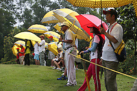 Galleries adorned with yellow Maybank umbrellas during the Final Round of the 2014 Maybank Malaysian Open at the Kuala Lumpur Golf & Country Club, Kuala Lumpur, Malaysia. Picture:  David Lloyd / www.golffile.ie