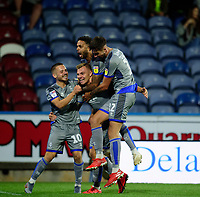 Lincoln City's Harry Anderson, (26), celebrates scoring the opening goal with team-mates Jack Payne, left, and Bruno Andrade and Ellis Chapman, right<br /> <br /> Photographer Andrew Vaughan/CameraSport<br /> <br /> The Carabao Cup First Round - Huddersfield Town v Lincoln City - Tuesday 13th August 2019 - John Smith's Stadium - Huddersfield<br />  <br /> World Copyright © 2019 CameraSport. All rights reserved. 43 Linden Ave. Countesthorpe. Leicester. England. LE8 5PG - Tel: +44 (0) 116 277 4147 - admin@camerasport.com - www.camerasport.com
