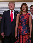 United States President Donald J. Trump and first lady Melania Trump participates in a photo op with senior military leaders and their spouses in the State Dining Room of the White House in Washington, DC on Monday, October 7, 2019. <br /> Credit: Ron Sachs / Pool via CNP