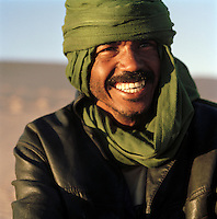 Portrait of a Tuareg guide laughing, Libya