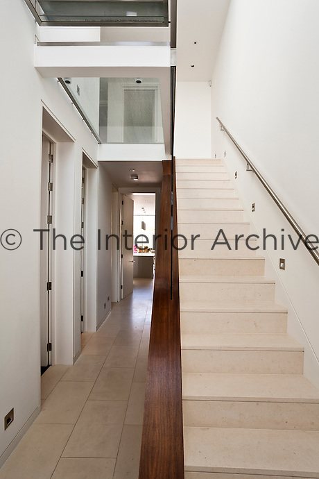 This entrance hall has been left free from decoration to highlight the beauty of the pale limestone floor