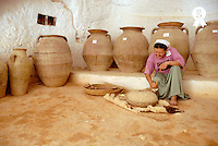 Woman in Troglodyte house showing ancient mill (Licence this image exclusively with Getty: http://www.gettyimages.com/detail/85071233 )
