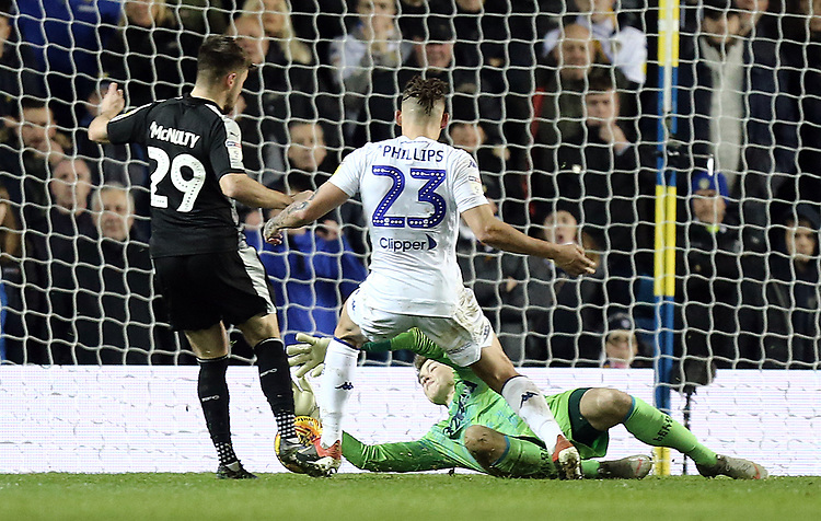 Leeds United's Bailey Peacock-Farrell gathers under pressure from Reading's Marc McNulty<br /> <br /> Photographer Rich Linley/CameraSport<br /> <br /> The EFL Sky Bet Championship - Leeds United v Reading - Tuesday 27th November 2018 - Elland Road - Leeds<br /> <br /> World Copyright © 2018 CameraSport. All rights reserved. 43 Linden Ave. Countesthorpe. Leicester. England. LE8 5PG - Tel: +44 (0) 116 277 4147 - admin@camerasport.com - www.camerasport.com