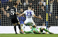Leeds United's Bailey Peacock-Farrell gathers under pressure from Reading's Marc McNulty<br /> <br /> Photographer Rich Linley/CameraSport<br /> <br /> The EFL Sky Bet Championship - Leeds United v Reading - Tuesday 27th November 2018 - Elland Road - Leeds<br /> <br /> World Copyright &copy; 2018 CameraSport. All rights reserved. 43 Linden Ave. Countesthorpe. Leicester. England. LE8 5PG - Tel: +44 (0) 116 277 4147 - admin@camerasport.com - www.camerasport.com