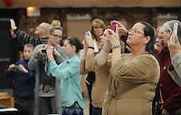 NWA Democrat-Gazette/ANDY SHUPE<br /> Rebecca Pianalto (right), a member of the St. Joseph Catholic Church in Tontitown, takes photographs of Items used by Donald Nohs, director general of the Confraternity of the Passion International, in his presentation about the Should of Turin Saturday, Jan. 16, 2016, at the church.
