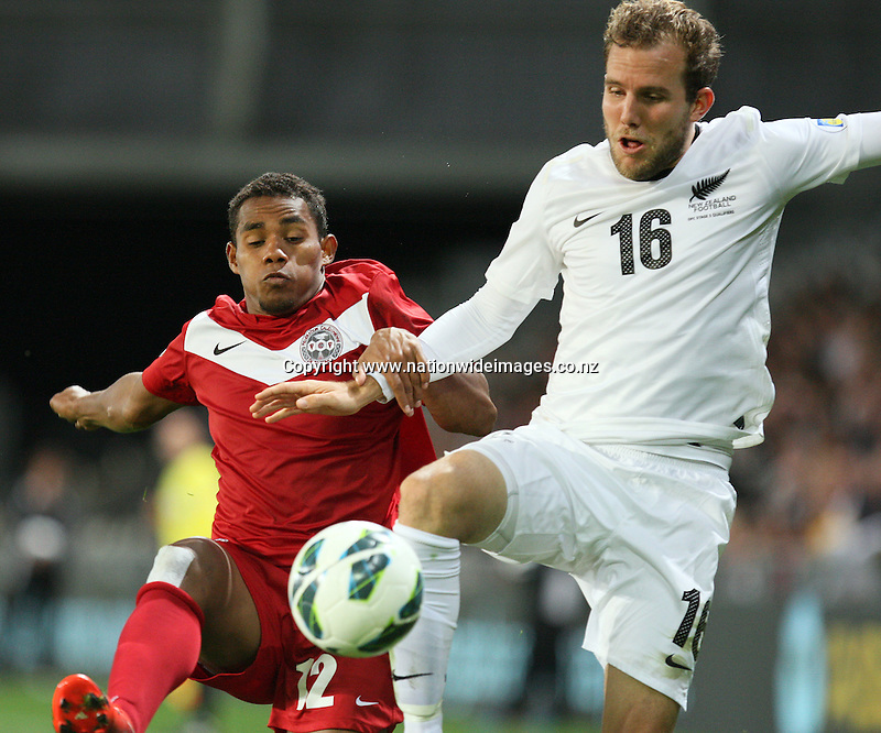 New Zealand's Jeremy Brockie, right, and  New Caledonia's Roy KaYara compete for the ball in the 2014 FIFA World Cup Brazil Oceania qualifier, Forsyth Barr Stadium, Dunedin, New Zealand, Friday, March 22, 2013. Credit:NINZ/Dianne Manson