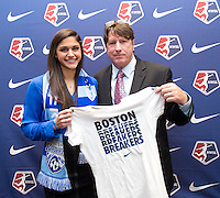 #34 overall pick Kim DeCesare of the Boston Breakers stands with head coach Tom Durkin during the NWSL draft at the Pennsylvania Convention Center in Philadelphia, PA, on January 17, 2014.