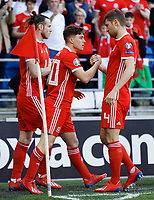 Daniel James of Wales (C) celebrates his goal with Gareth Bale (L) and Ben Davies (R) during the UEFA EURO 2020 Qualifier match between Wales and Slovakia at the Cardiff City Stadium, Cardiff, Wales, UK. Sunday 24 March 2019