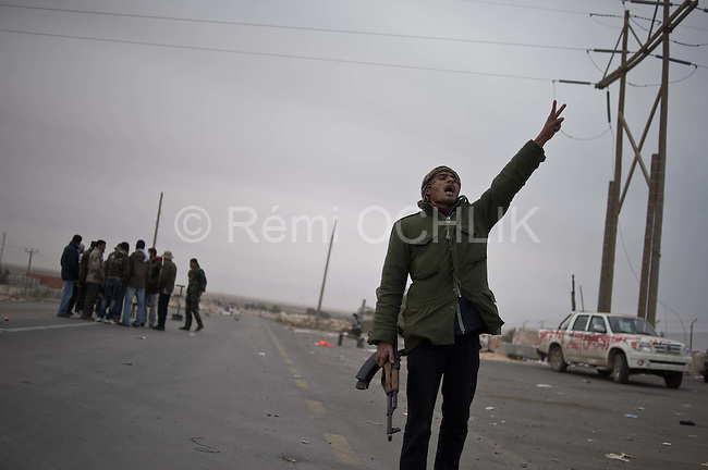 © Remi OCHLIK/IP3 -   Brega  March 13, 2011 - Troops of colonel Muamar Gadhafi bombs heavily the opposition forces checkpoint outside the strategic oil town of Brega. Rebels were pushed away, and retreated to Al Badjiya..
