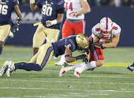 Annapolis, MD - November 11, 2017: Navy Midshipmen safety Sean Williams (6) tackles Southern Methodist Mustangs quarterback Ben Hicks (8) during the game between SMU and Navy at  Navy-Marine Corps Memorial Stadium in Annapolis, MD.   (Photo by Elliott Brown/Media Images International)