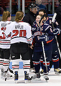 Annie Hogan (NU - 3), Katy Applin (NU - 20), Amy Hollstein (UConn - 10) - The University of Connecticut Huskies defeated the Northeastern University Huskies 4-1 in Hockey East quarterfinal play on Saturday, February 27, 2010, at Matthews Arena in Boston, Massachusetts.