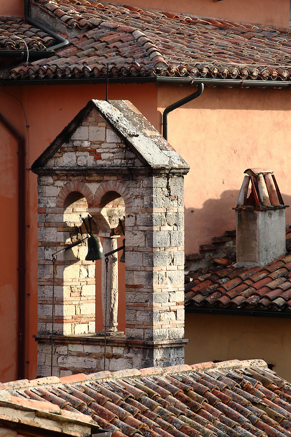 A classic photo from Todi: the small nice bell-tower surrounded by the characteristic roofs covered by reddish shingles renders the warm atmosphere of the old town. Digitally Improved Photo.