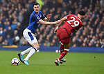 Michael Keane of Everton is challenged by Dominic Solanke of Liverpool during the premier league match at Goodison Park Stadium, Liverpool. Picture date 7th April 2018. Picture credit should read: Robin Parker/Sportimage