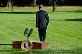 """United States President Obama walks to Marine 1 after delivering a statement on Ebola from  the South Lawn of the White House in Washington, D.C. on Tuesday, October 28, 2014. In his remarks the President said America """"cannot shy away"""" from leadership.  He then departed for Milwaukee for campaign events, and is scheduled to return tonight.<br /> Credit: Olivier Douliery / Pool via CNP"""