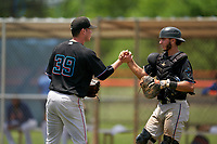 GCL Marlins pitcher Codie Paiva (39) shakes hands with catcher Cameron Barstad (6) after closing out a Gulf Coast League game against the GCL Mets on August 11, 2019 at St. Lucie Sports Complex in St. Lucie, Florida.  The Marlins defeated the Mets 3-2 in the second game of a doubleheader.  (Mike Janes/Four Seam Images)