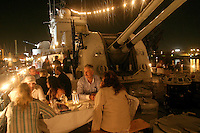 People on the deck of former war ship, now museum piece, Småland. As part of the festival Göteborgskalaset part of the ship was made into a restaurant.