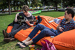 Artyom Kritsin, left, plays the guitar as his friend Vladimir Gavrikov listens in Gorky Park on Saturday, August 17, 2013 in Moscow, Russia.