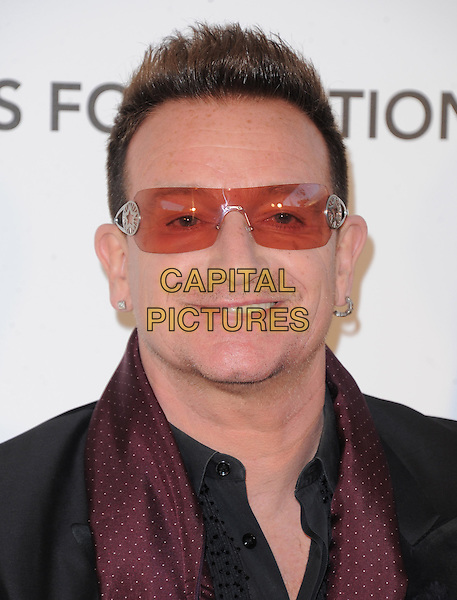 Bono of U2 (Paul David Hewson).The 21st Annual Elton John AIDS Foundation Academy Awards Viewing Party held at The City of West Hollywood Park in West Hollywood, California, USA..February 24th, 2013.oscars headshot portrait red black sunglasses shades                                                    .CAP/DVS.©DVS/Capital Pictures.