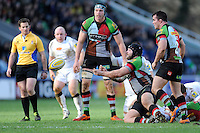 Mark Lambert of Harlequins keeps play going as he is tackled during the Aviva Premiership match between Harlequins and Newcastle Falcons at the Twickenham Stoop on Saturday 15th February 2014 (Photo by Rob Munro)
