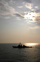 Arleigh Burke-class destroyer alongside USS Abraham Lincoln.
