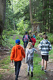 CANADA, Vancouver, British Columbia, family and friends walk to to Brigade Bay on Gambier Island, in the Howe Sound