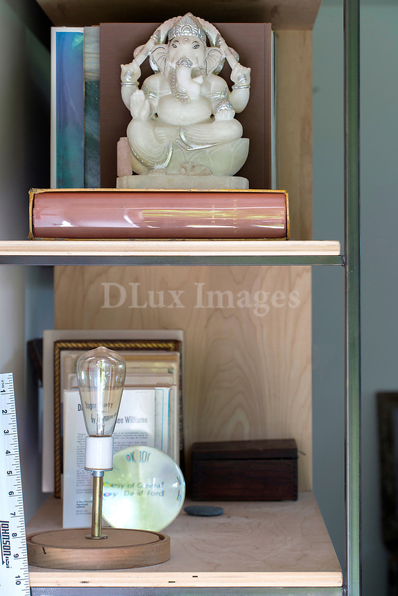 Statuette on wooden shelf