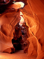The interior of Upper Antelope Canyon near Page Arizona is bathed in light from the midday sun.