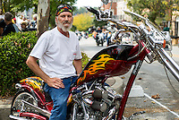 NWA Democrat-Gazette/JASON IVESTER<br /> Bikes, Blues & BBQ on Thursday, Sept. 24, 2015, in Fayetteville<br /> Shawn Hutchinson of Wesley sits on his bike on Thursday, Sept. 24, 2015, on Dickson Street during Bikes, Blues & BBQ in Fayetteville.