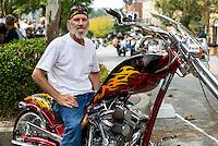 NWA Democrat-Gazette/JASON IVESTER<br /> Bikes, Blues &amp; BBQ on Thursday, Sept. 24, 2015, in Fayetteville<br /> Shawn Hutchinson of Wesley sits on his bike on Thursday, Sept. 24, 2015, on Dickson Street during Bikes, Blues &amp; BBQ in Fayetteville.