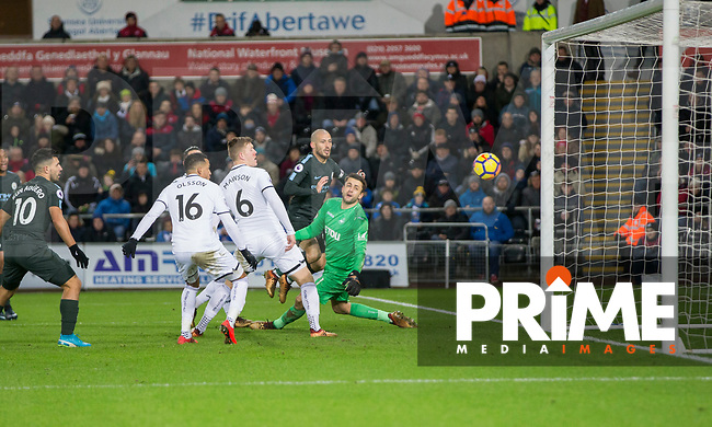 David Silva of Manchester City scores his side's third goal during the EPL - Premier League match between Swansea City and Manchester City at the Liberty Stadium, Swansea, Wales on 13 December 2017. Photo by Mark  Hawkins / PRiME Media Images.