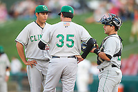 Clinton LumberKings pitching coach Andrew Lorraine #35 talks with pitcher Robert Shore #24 and catcher Michael Dowd #29 during a Midwest League game against the Kane County Cougars at Fifth Third Ballpark on August 16, 2012 in Geneva, Illinois.  Kane County defeated Clinton 5-3.  (Mike Janes/Four Seam Images)