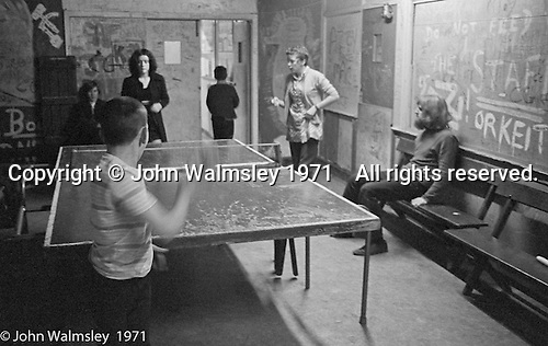 Table tennis, Scotland Road Free School, Liverpool  1971.  Also known as the Scotland Road or Scottie Road Free School it was founded and run by two teachers, John Ord and Bill Murphy (if I've got these names wrong, please tell me!) who worked with truanting kids and provided somewhere to go and things to do.  They begged and borrowed an old building, desks, books and an old ambulance for trips.  John Sugden (on right with beard).